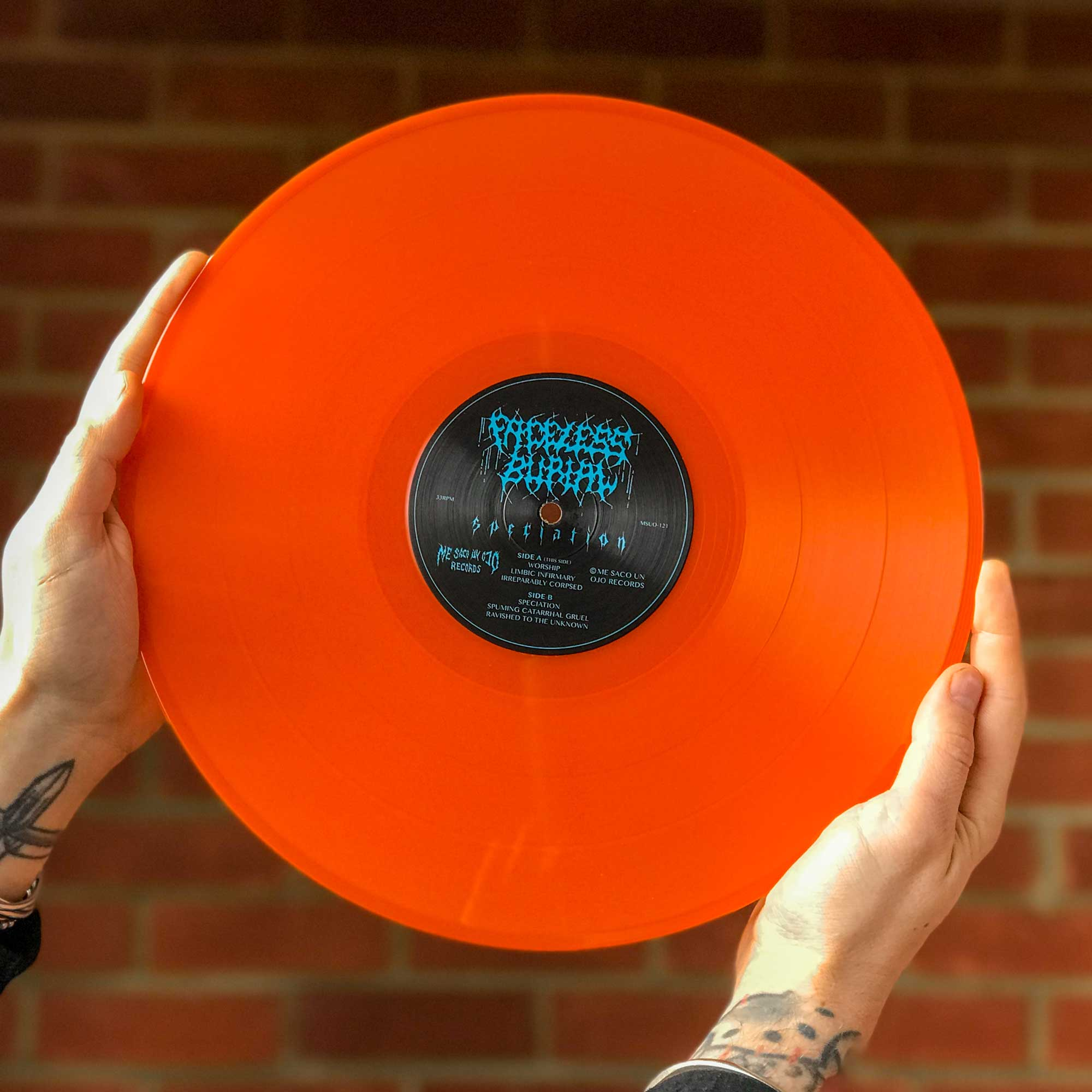 A photo of the Speciation vinyl in Orange Crush colour